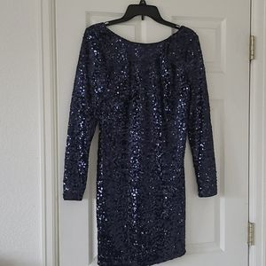 Sequined, lined fully lined evening dress.